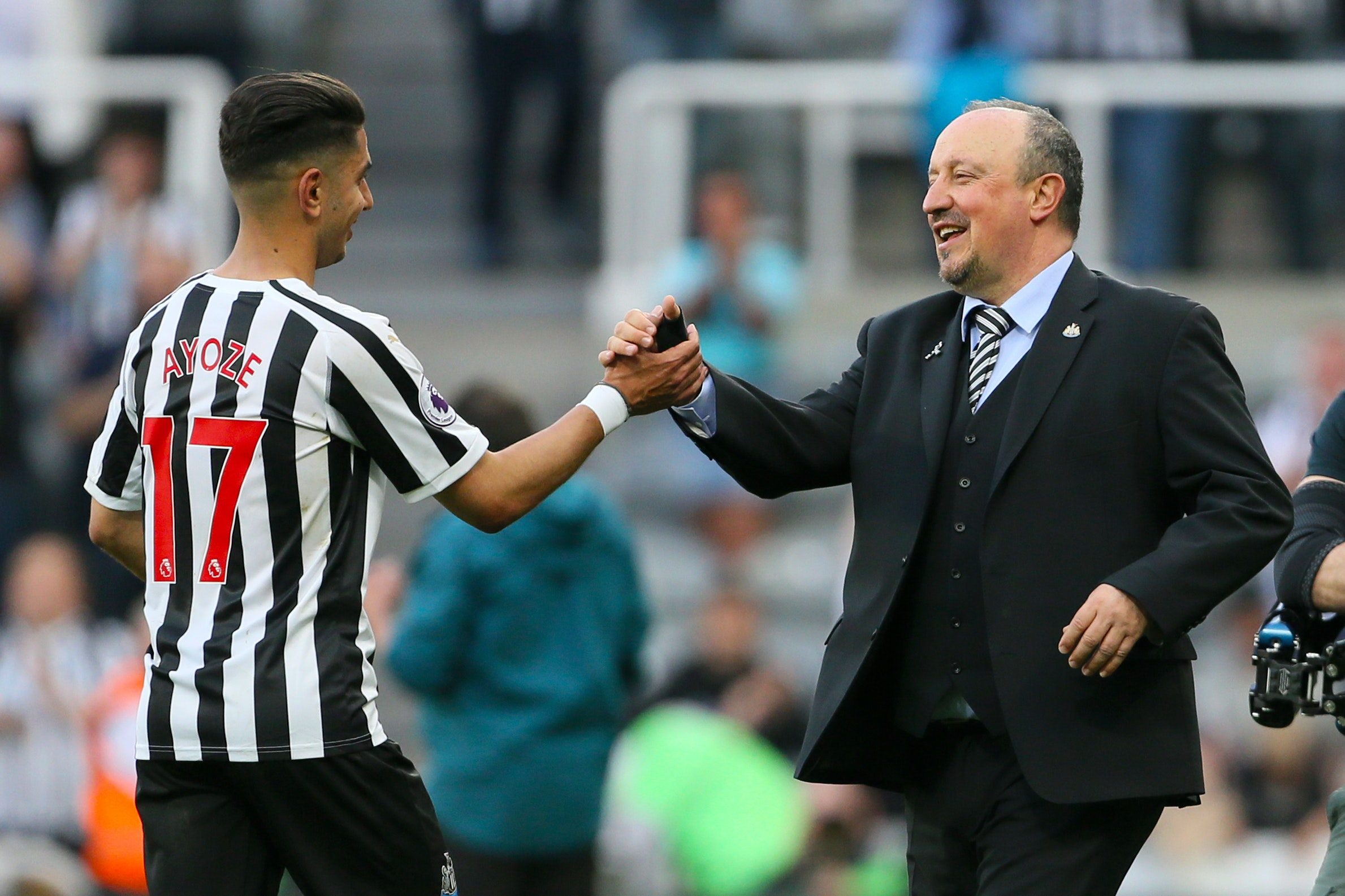 Newcastle manager Rafael Benitez celebrates with match-winner Ayoze Perez