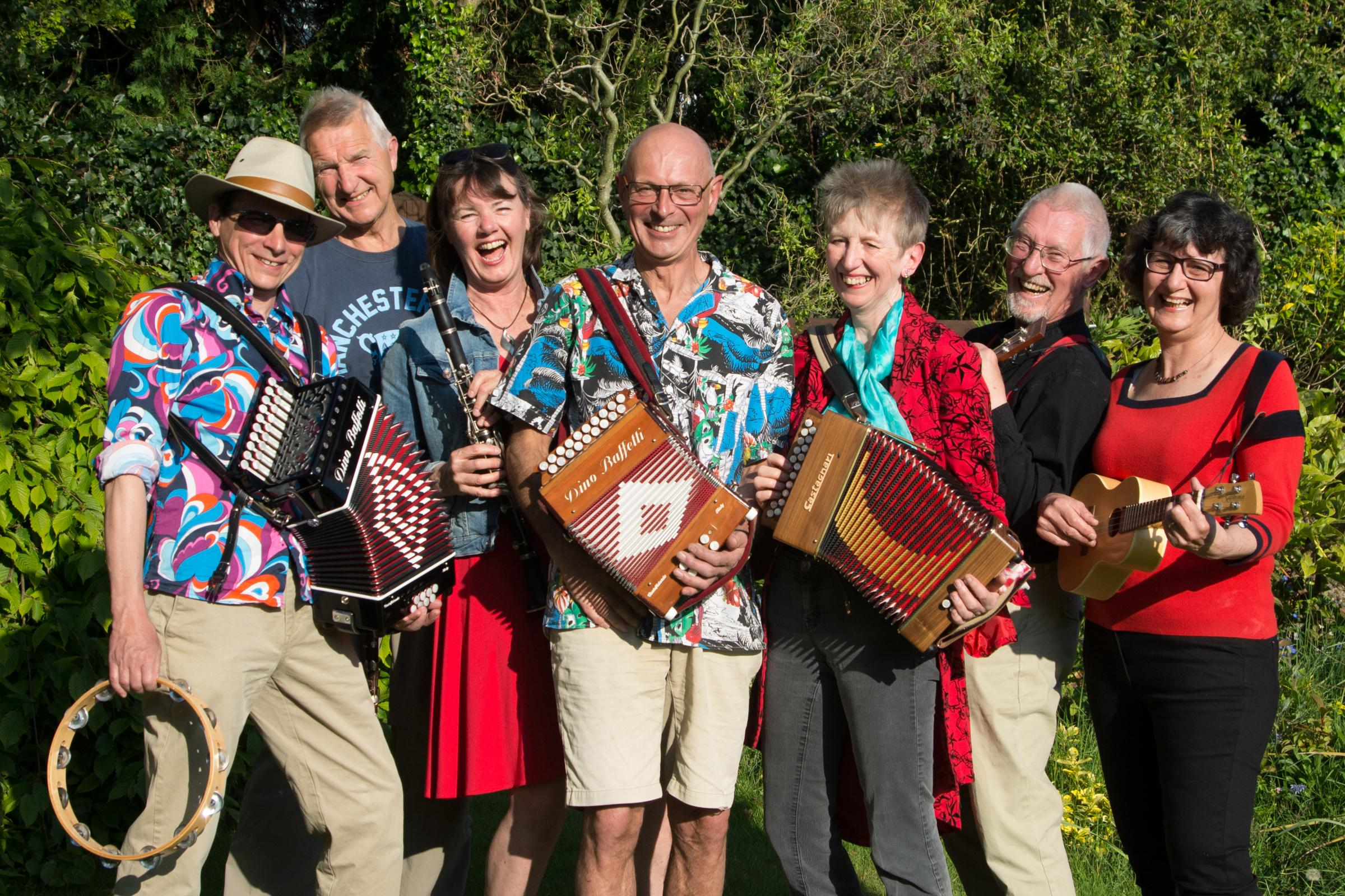 The Fizzjigs band prepares for the football-free ceilidh on June 1. Bob Richards, Steve Thomas, Anna Hayes, Peter Cartlidge, Jan Hoole, Roger Garland, Mirjana Garland.