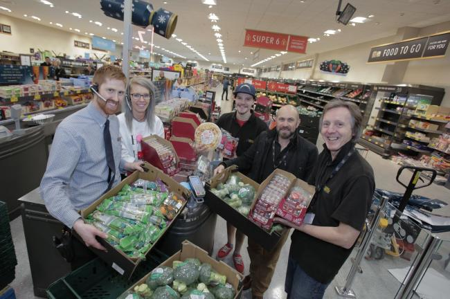 Aldi employees with food donations