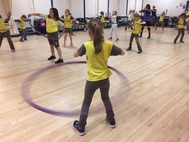 2nd Ellesmere Brownies hula hooping their way towards sporting badge