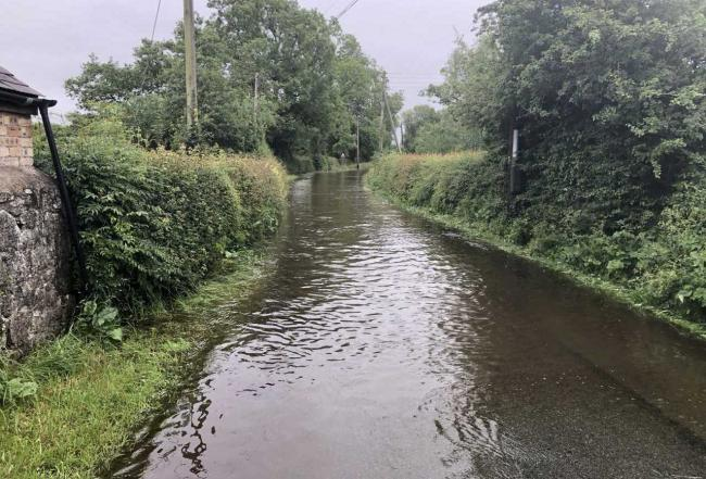 A flooded road between Maesbrook and Melverly